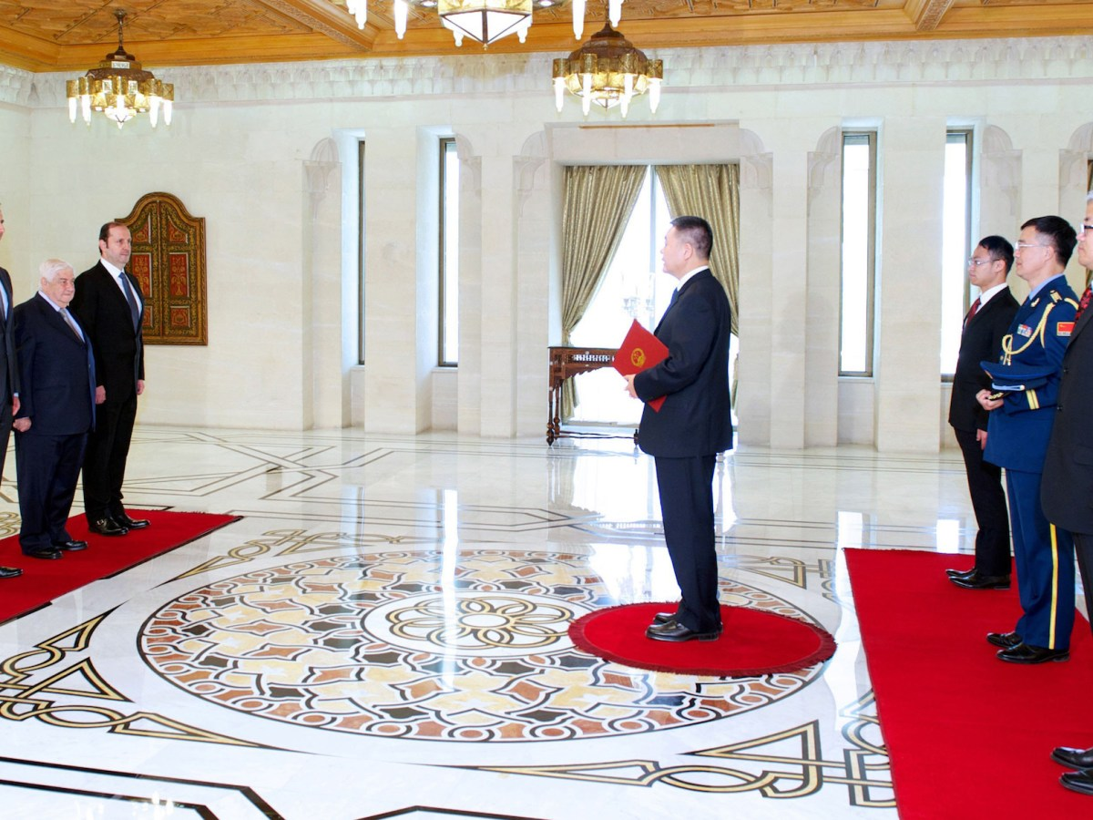 Syrian President Bashar al-Assad (L) accepting the credentials of Wang Qi Jian, the new ambassador of the People's Republic of China to Syria, in Damascus on June 9, 2014. Photo: AFP/HO/SANA
