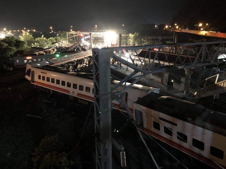 At least 18 people died and 160 were injured when a train derailed in northeastern Taiwan on Sunday. Photo: AFP