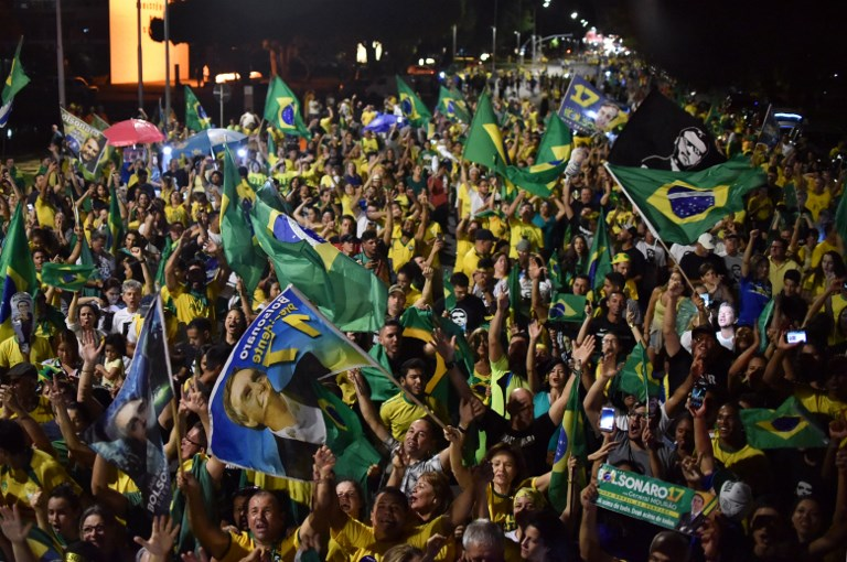 Supporters of Brazilian President-elect Jair Bolsonaro celebrate the candidate's victory at the Esplanade of the Ministries in Brasilia. Photo: Andre Borges / AGIF