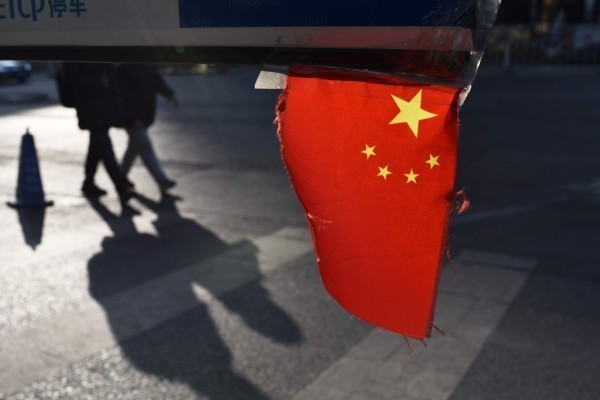 A Chinese flag is seen during a pro-unificiation rally in Taipei. Photo: AFP