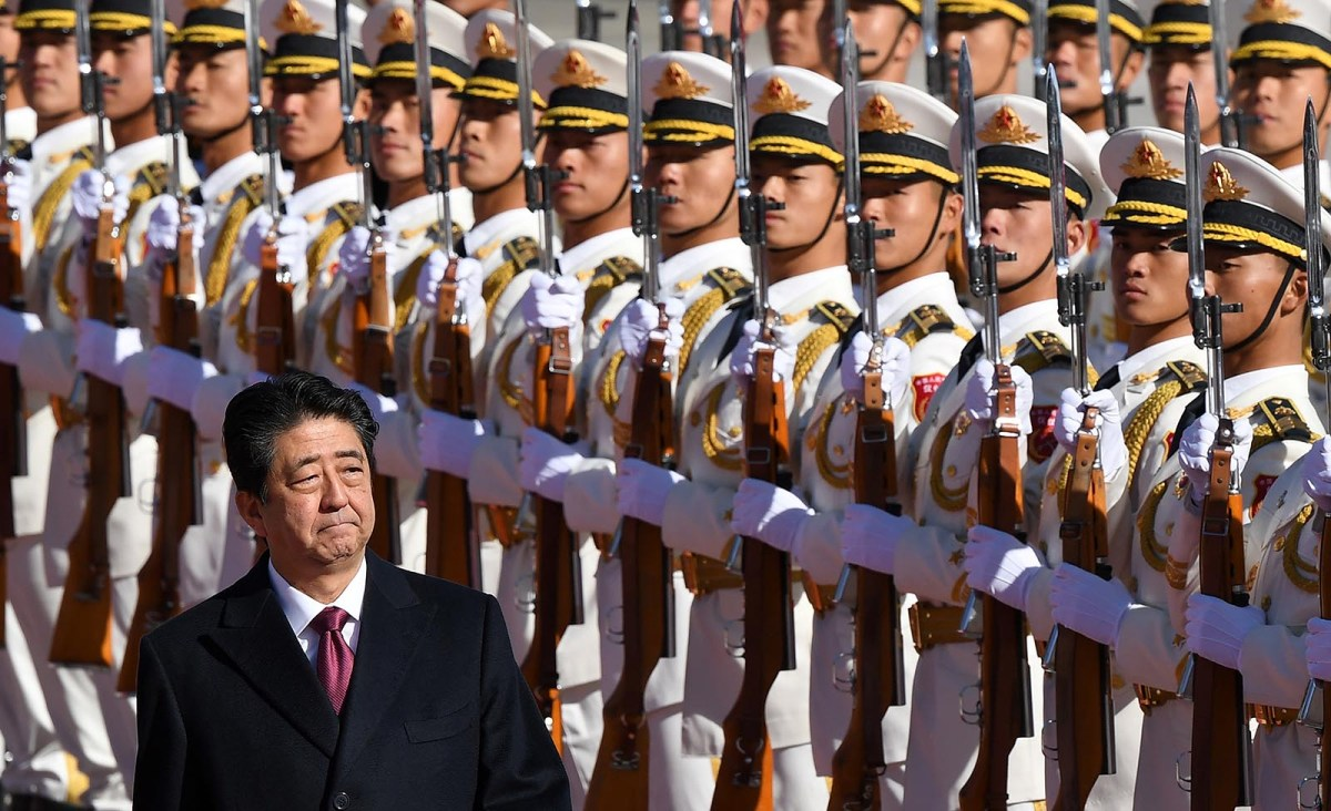 Japan's Prime Minister Shinzo Abe reviews a military honor guard during a welcome ceremony outside the Great Hall of the People in Beijing on October 26, 2018. Photo: AFP/Greg Baker