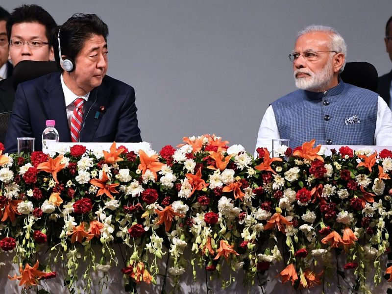 Japanese Prime Minister Shinzo Abe (L) and Indian Prime Minister Narendra Modi listens to a speaker at the India-Japan annual summit on September 14, 2017. Photo: AFP/Prakash Singh