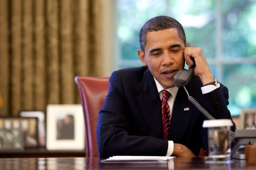 President Barack Obama talks on the telephone to the crew of the Space Shuttle Atlantis from the Oval Office, Wednesday, May 20, 2009. Official White House photo by Pete Souza.