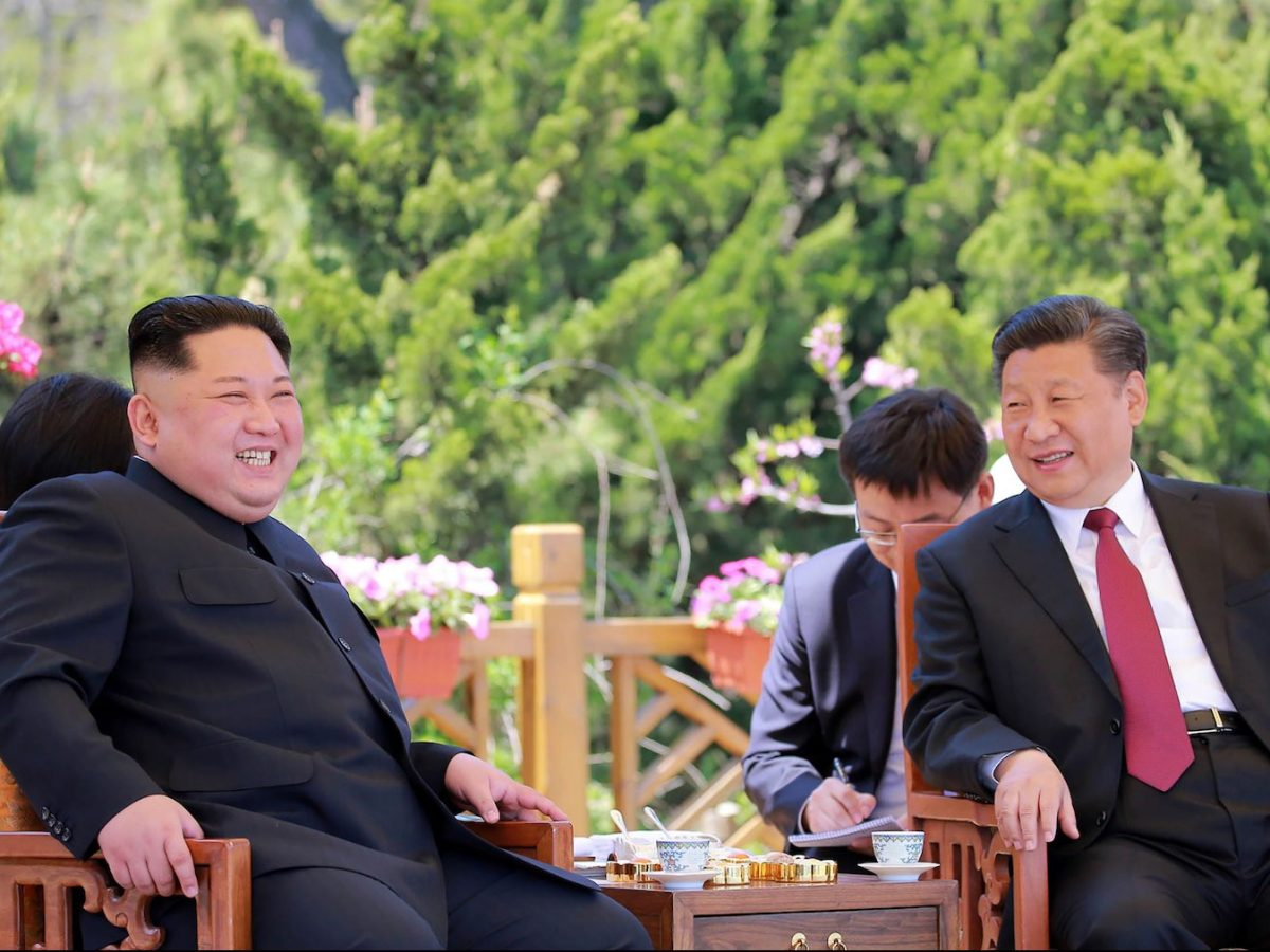 China's President Xi Jinping (R) and North Korean leader Kim Jong Un (L) during a meeting in the Chinese city of Dalian. Photo by KCNA via AFP