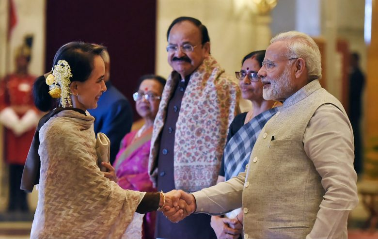 India's Prime Minister Narendra Modi (R) shaking hands with Myanmar's Myanmar's civilian leader Aung San Suu Kyi during the India-ASEAN commemorative summit in New Delhi. Photo: Handout via AFP