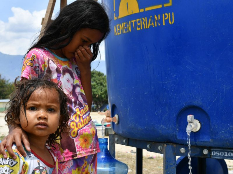 Children access usable water at a temporary camp in Palu in Central Sulawesi on October 4, 2018, after an earthquake and tsunami hit the area on September 28. Photo: AFP/Adek Berry