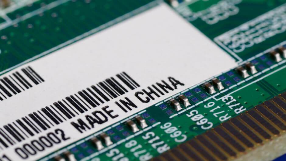 """A motherboard carrying a """"made in China"""" label. Photo: Xinhua"""