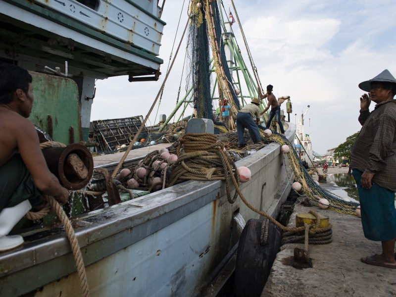 Myanmar workers prepare a fishing boat in Samut Sakhon in September. The IOM says Thailand needs ways to better protect these migrants from abuse and exploitation.Photo: AFP / Lillian Suwanrumpha