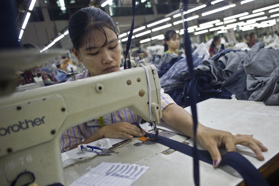 A worker at a garment factory in the Shwe Pyi Thar industrial zone in Yangon in a September 2015 file photo. Photo: AFP/Ye Aung Thu