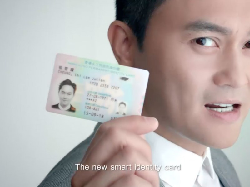 Hong Kong artist Julian Cheung poses with a new smart identity card. Photo: HK Government