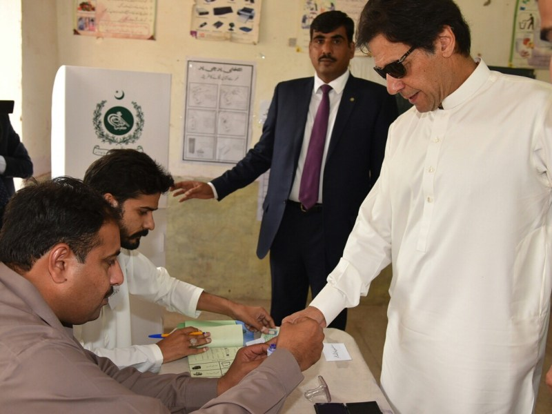 Prime Minister of Pakistan Imran Khan (R) casts his vote during by-elections on October 14. Photo: PRIME MINISTRY OFFICE OF PAKISTAN / HANDOUT / Anadolu Agency