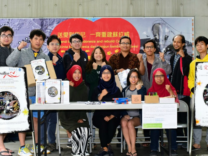 Students pose at their fundraising booth on campus. Photo: Chung Yuan Christian University