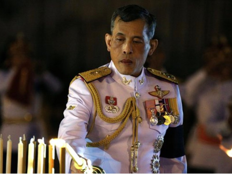 Thai King Maha Vajiralongkorn lights a candle at a sacred ceremony in a file photo. His formal coronation is due to be held in early May. Photo: Facebook
