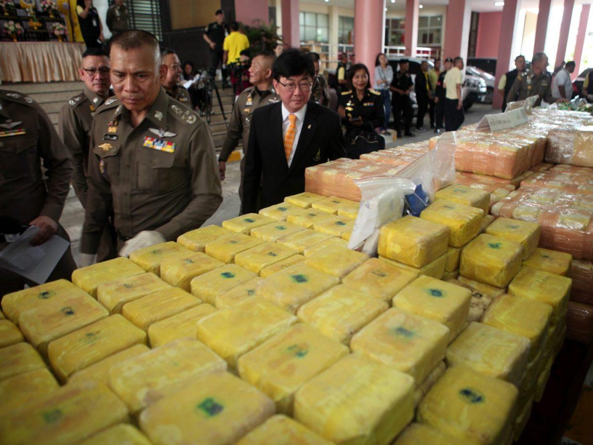 Police show off recent drug hauls including 9.8 million meth pills and 77kg of heroin in Chiang Rai. Photo: AFP/Bangkok Post/Apichart Jinakul