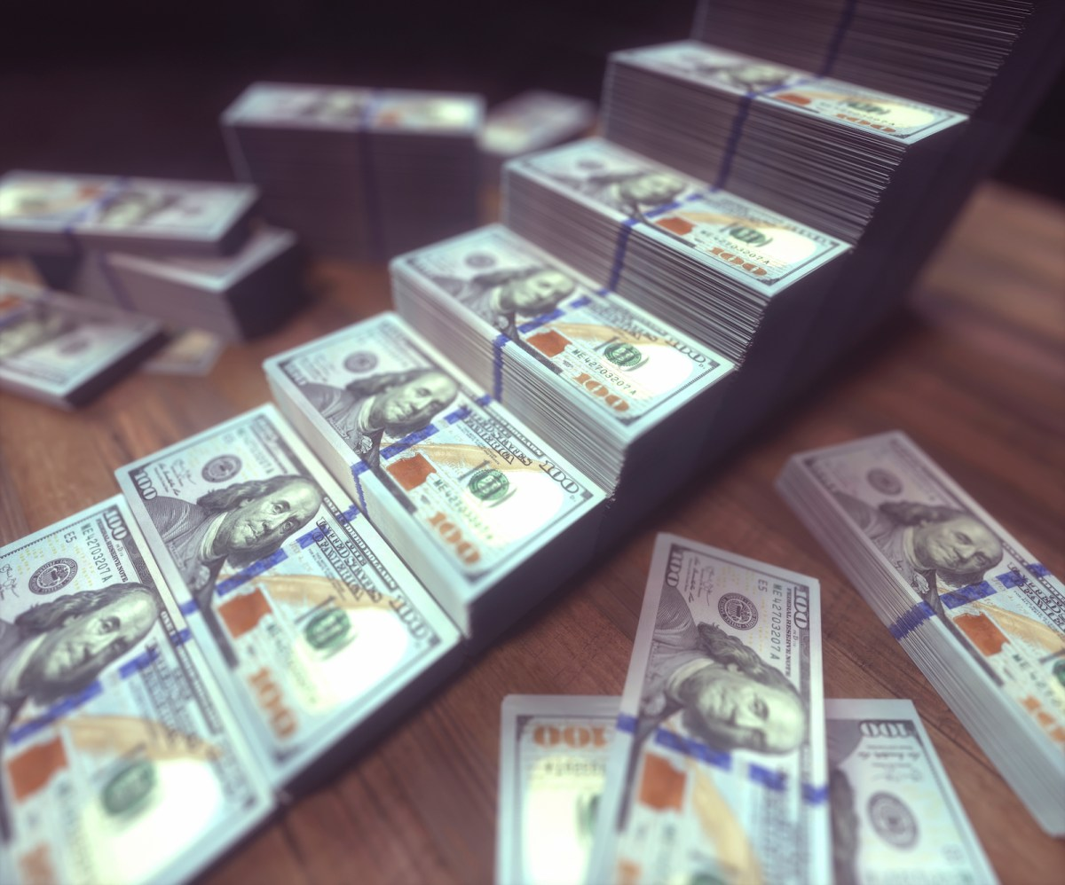 Stacks of one hundred US dollar banknotes, which may become more expensive for some. Photo: AFP/illustration