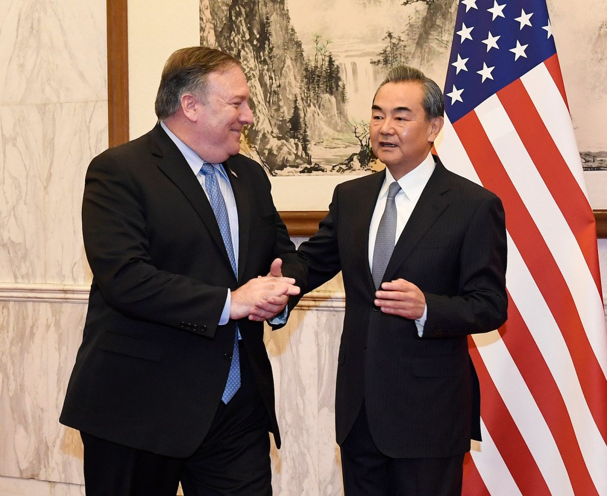 Chinese Foreign Minister Wang Yi (right) talks with US Secretary of State Mike Pompeo before their meeting in Beijing on October 8, 2018. Photo: AFP / Daisuke Suzuki