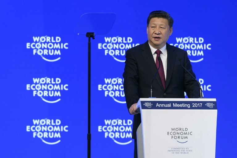 "Chinese President Xi Jinping delivers a speech during the first day of the World Economic Forum, on January 17, 2017, in Davos, Switzerland. Photo: AFPChinese President Xi Jinping said on January 17, 2017 that there is ""no point"" in blaming economic globalisation for the world's problems. The leader of the world's second largest economy made the comment at the World Economic Forum, where he is making his first appearance as China seeks to play a greater role in world trade regimes amid rising protectionism in the US and Europe. The global elite begin a week of earnest debate and Alpine partying in the Swiss ski resort of Davos, in a week bookended by two presidential speeches of historic import. / AFP PHOTO / FABRICE COFFRINI"