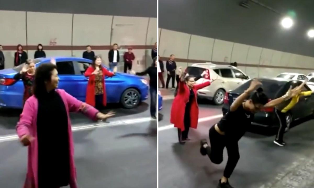 Half a dozen women dance to forget traffic congestion. Photo: Baidu