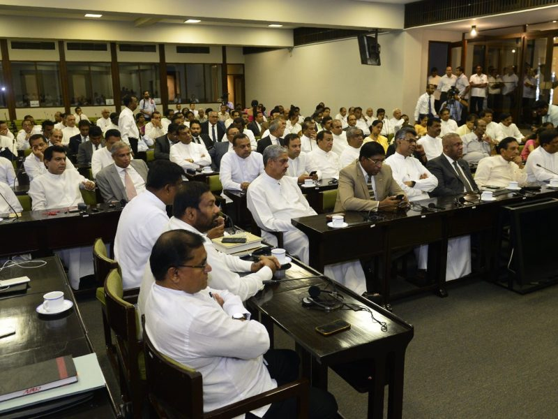 Sri Lankan MPs attend a meeting with parliamentary Speaker Karu Jayasuriya at the Parliament Building in Colombo. Photo: AFP/Lakruwan Wanniarachchi