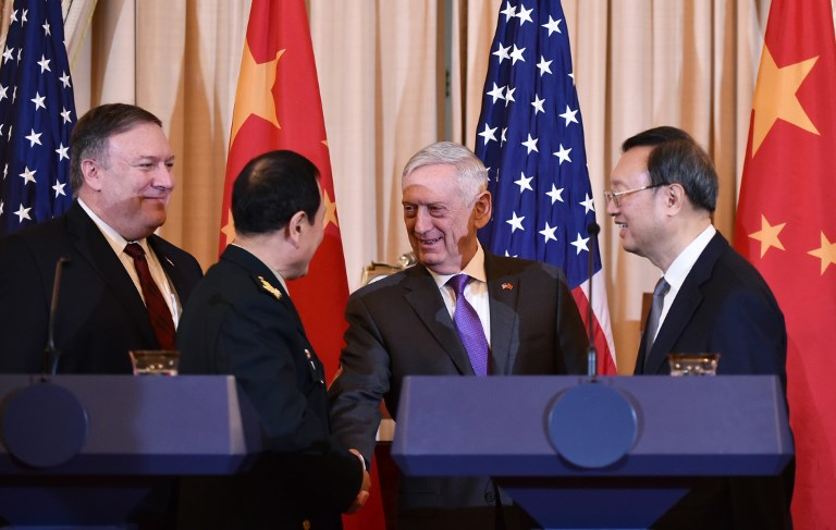 US Secretary of Defense Jim Mattis shakes hands with Chinese Defense Minister Wei Fenghe watched by US Secretary of State Mike Pompeo Chinese Politburo member Yang Jiechi. Photo: AFP