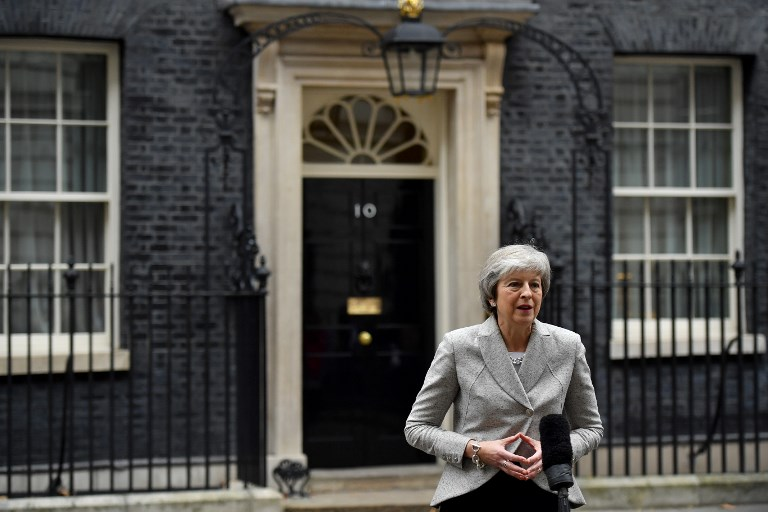 British Prime Minister Theresa May gives a statement outside 10 Downing Street in central London on Thursday following the announcement of a draft deal on post-Brexit trade ties with the EU. Photo: AFP