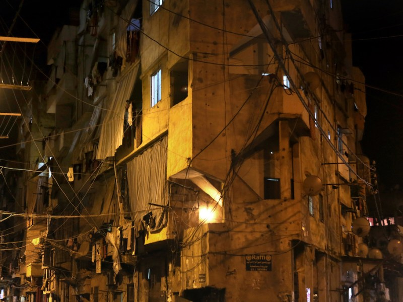 Electric wires hang between buildings in an eastern suburb of Beirut. Photo: Patrick Baz / AFP