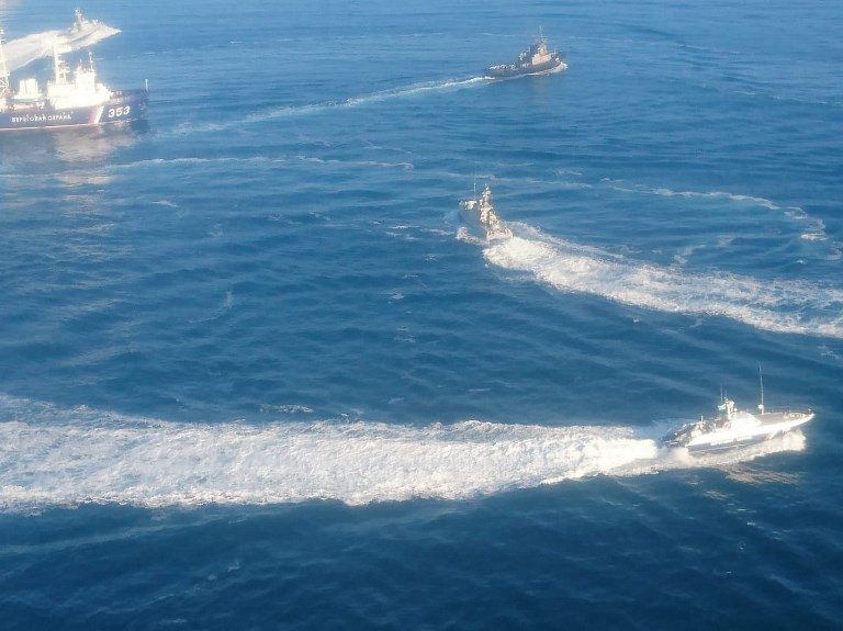 In this handout photo distributed by the Russian Federal Security Service, three Ukrainian naval ships cross what Moscow claims as the Russian border. Photo: Russian Federal Security Service via AFP