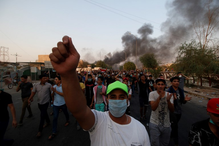 People march during the funeral of a demonstrator who died during a protest against unemployment, corruption and a lack of public services in Basra, Iraq, on September 7. Photo: Haider El Esedi / Anadolu Agency