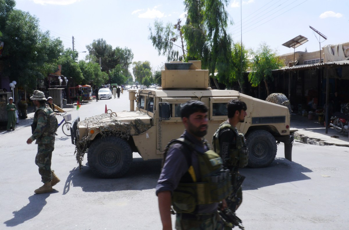 Afghan security forces on patrol after recapturing control of Farah from Taliban militants on May 16,  2018. Photo: AFP / Hameed Khan