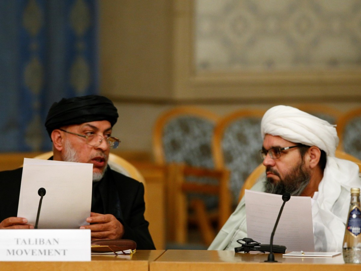 Sher Mohammad Abbas Stanakzai, head of the Taliban's political office, left, attends peace talks on Afghanistan at the President Hotel in Moscow on November 9, 2018. Photo: AFP / Sefa Karacan / Anadolu Agency