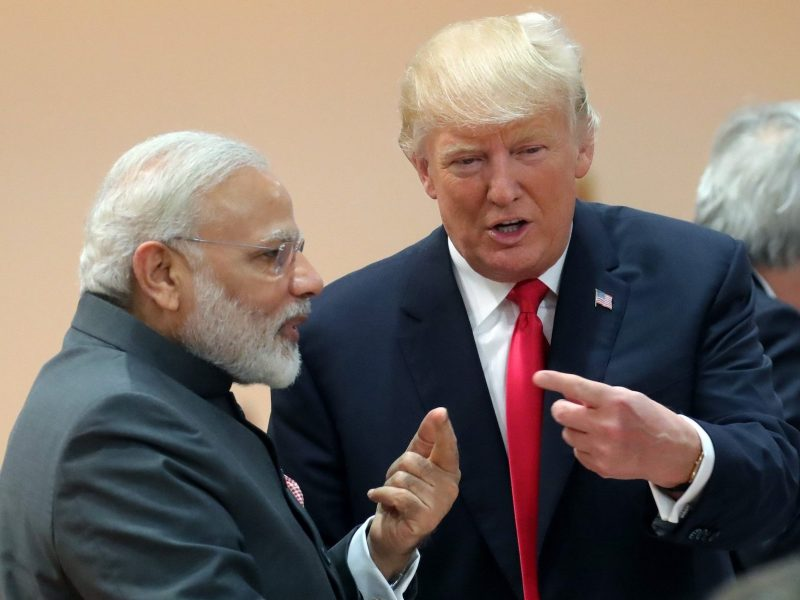 US President Donald Trump (R) talks with India's Prime Minister Narendra Modi as they attend a working session during the G20 summit in Hamburg, northern Germany, on July 8, 2017. Photo: AFP/ Michael Kappeler/Pool