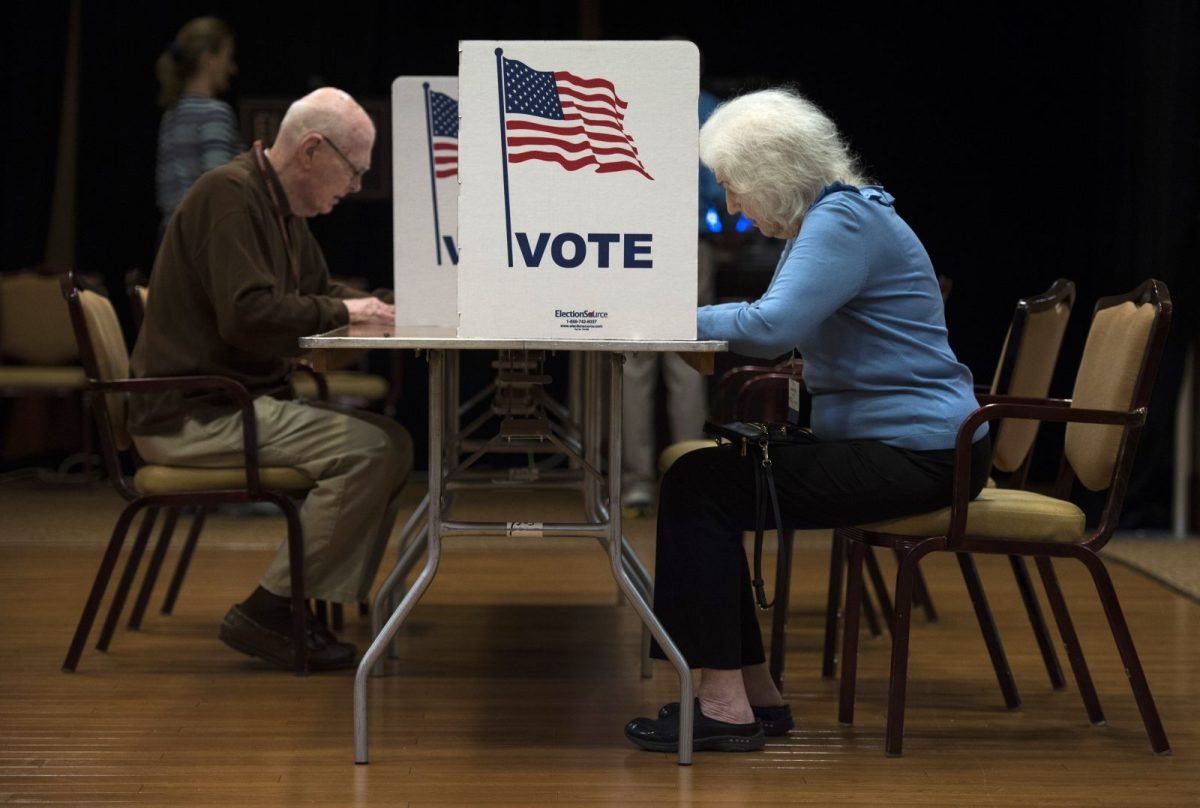 People vote at the Greenspring Retirement center during the mid-term elections in Fairfax, Virginia, on November 6, 2018. Photo: AFP/Andrew Caballero-Reynolds