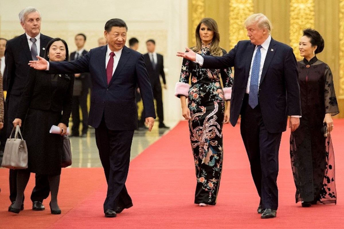 China's President Xi Jinping, seen here with US President Donald Trump in Beijing in 2017 with First Lady Melania, and his wife Peng Liyuan, has also admitted facing internal divisions over economic policy. Photo: AFP / Jim Watson
