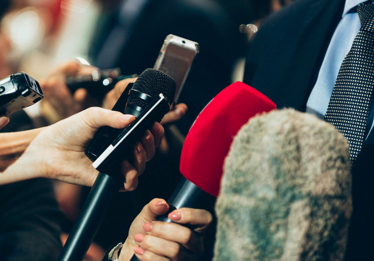 Interviewing business man on press conference. Photo: iStock