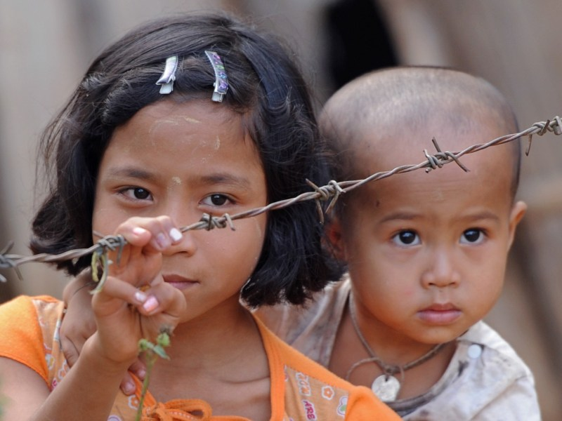 Karen children next to a barbed wire fence at Mae La refugee camp in Mae Sot near the Thai-Myanmar border. At least 87,000 people remain in the camps which were set up in 1984. Photo: AFP/Pornchai Kittiwongsakul
