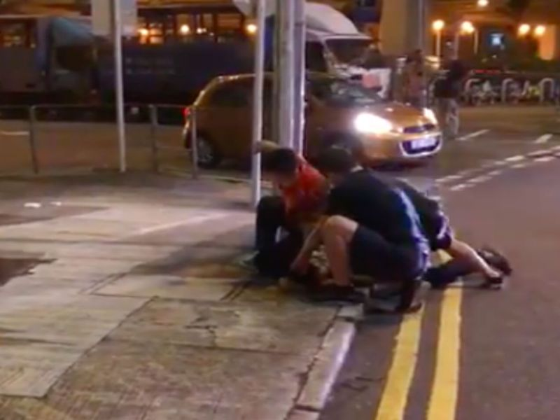 Three men subdue a man, 42, after he allegedly damaged a racing car in Tai Wai in the New Territories. Photo: Facebook, 馬路的事討論區,Kim Fung
