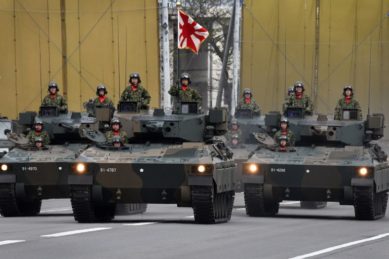 A tank unit of the Ground Self-Defence Force (GSDF) takes part in a military review at the GSDF Asaka training ground in Asaka, Saitama prefecture on October 14, 2018. - Some 4,000 personnel, 260 vehicles and 40 aircraft took part in the military parade. (Photo by Kazuhiro NOGI / AFP)
