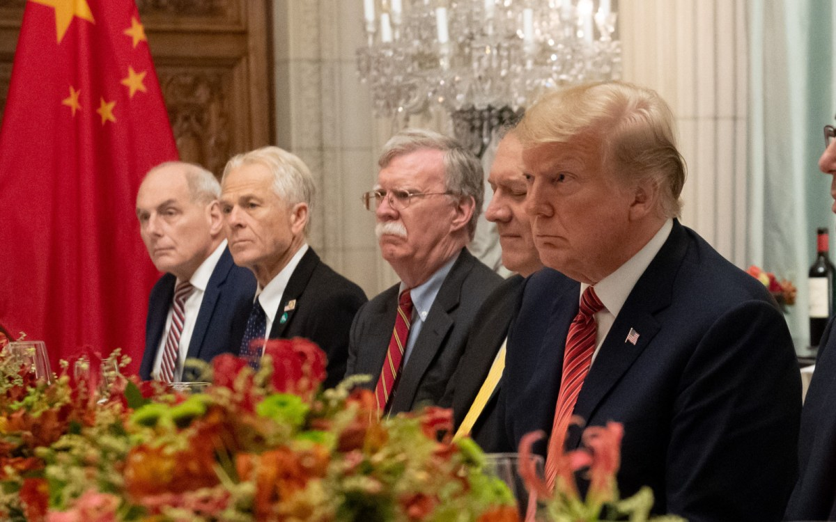 The Trump administration's mustachioed national security adviser, John Bolton, sitting with his team opposite the Chinese delegation in Buenos Aires. Photo: AFP