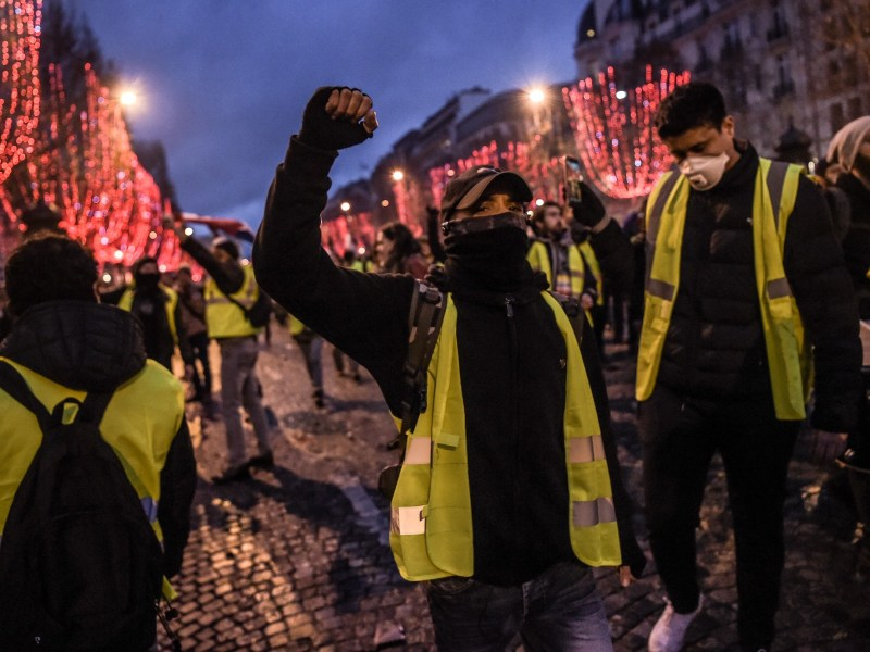 Protesters wearing yellow vests (gilets jaunes) demonstrate against rising costs of living on the Champs-Elysees in Paris on December 8, 2018. Photo: Lucas Barioulet / AFP