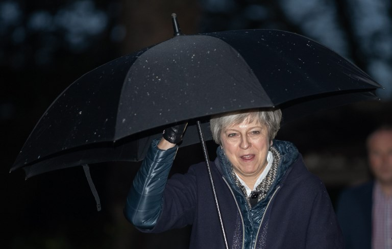 British leader Theresa May arrives for a church service near her Maidenhead constituency on Sunday. Photo: AFP