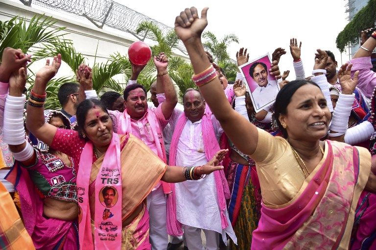 Telangana Rashtra Samiti members celebrate their party's victory in the state assembly elections at their office in Hyderabad on Tuesday. Photo: AFP