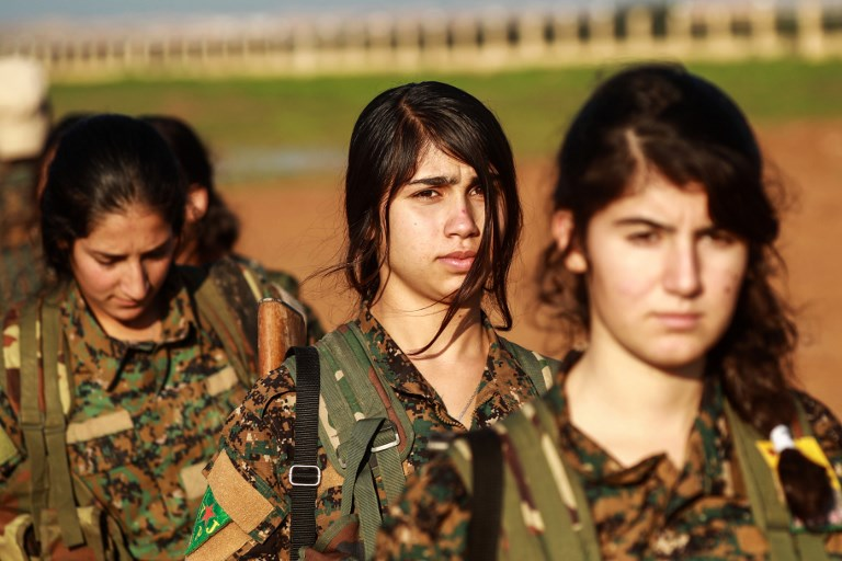 Kurdish fighters attend the funeral of a Syrian Democratic Forces fighter in the town of Tal Tamr in Syria's northeastern Hasakeh province on December 21. Observers say the planned withdrawal of American forces from Syria will put Kurdish fighters in Turkey's crosshairs. Photo: AFP