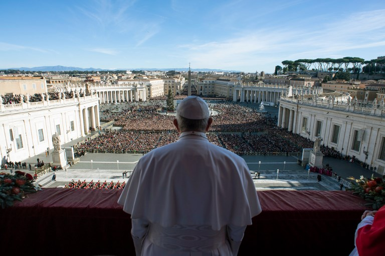 Pope Francis delivers his Christmas address from the balcony of St Peter's Basilica in Vatican City. Photo: AFP