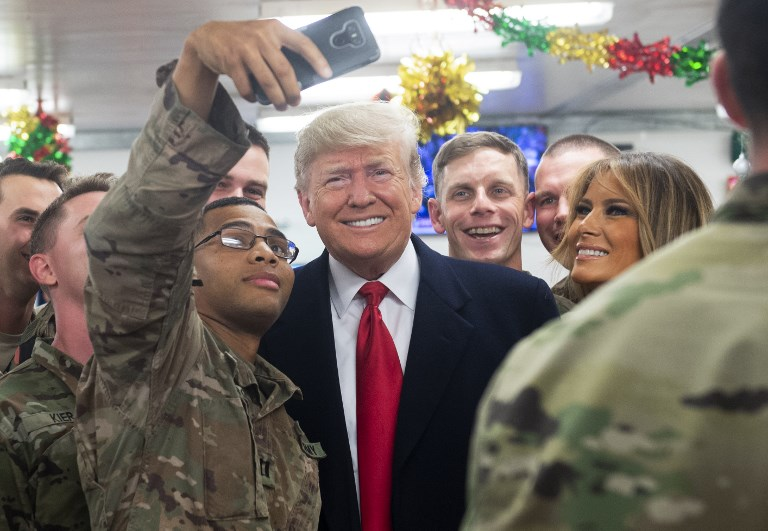 US President Donald Trump and First Lady Melania greet members of the US military during an unannounced trip to Al Asad Air Base in Iraq on Wednesday. Photo: AFP