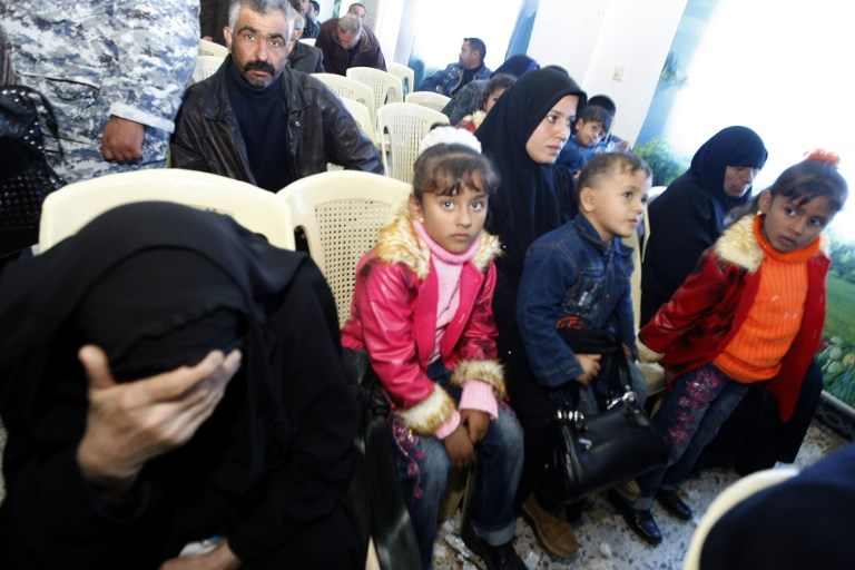 In this 2008 file photo, an Iraqi woman whose husband was murdered by Blackwater security guards sits with her children during a meeting with US Federal prosecutors to discuss the case against the security firm at the central police station in Baghdad. Photo: AFP