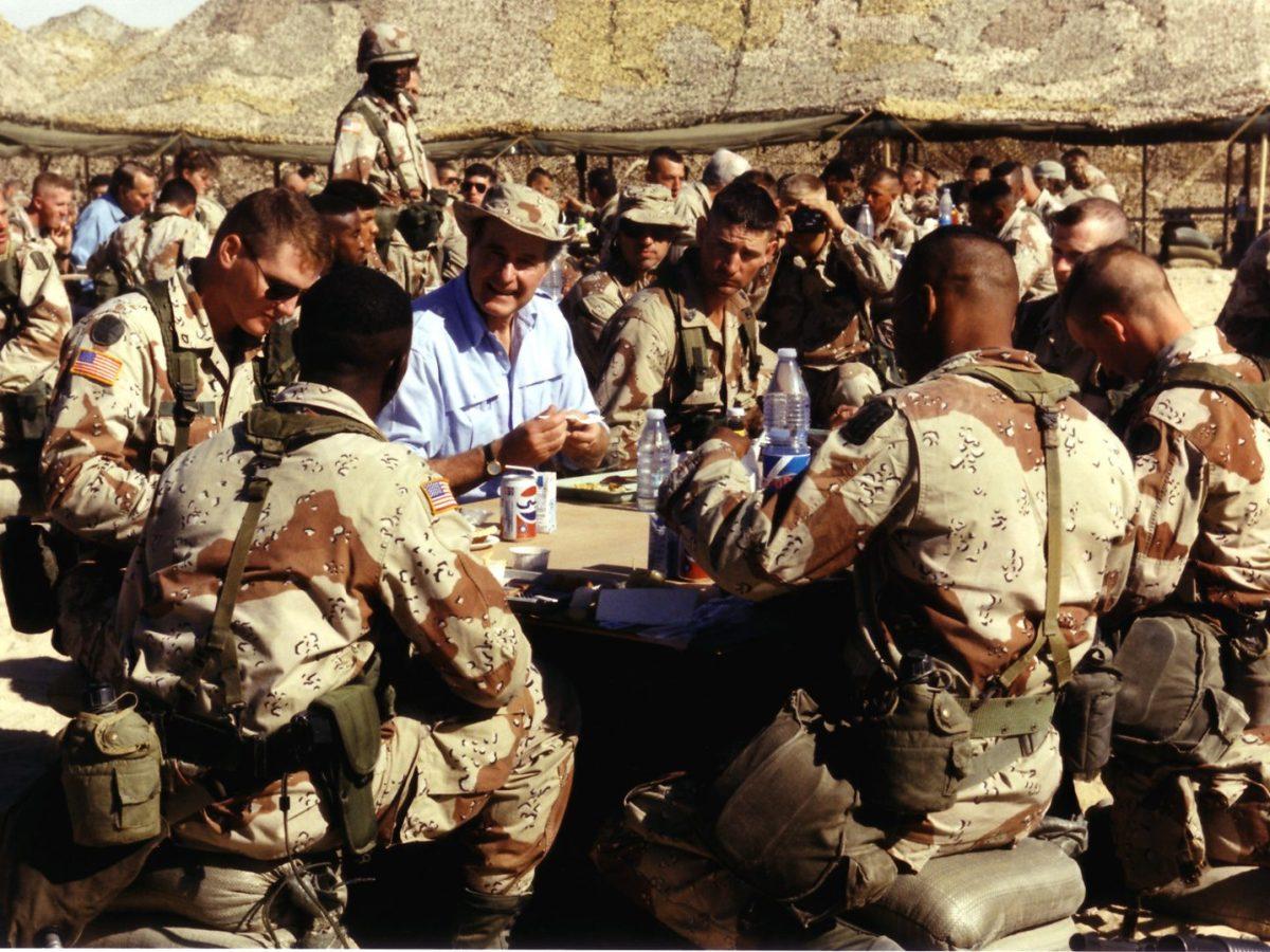 United States President George HW Bush shares Thanksgiving with US military personnel in Saudi Arabia on November 22, 1990. Photo: David Valdez, White House via CNP