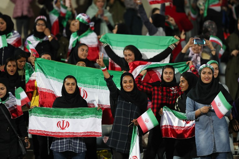 Women cheer during a friendly soccer match between Iran and Bolivia at Azadi Stadium in Tehran in October. Photo: AFP
