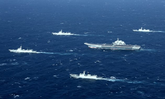 A file photo shows China's Liaoning aircraft carrier with an accompanying fleet conducting a drill in the South China Sea. Photo: Reuters / Stringer / File Photo