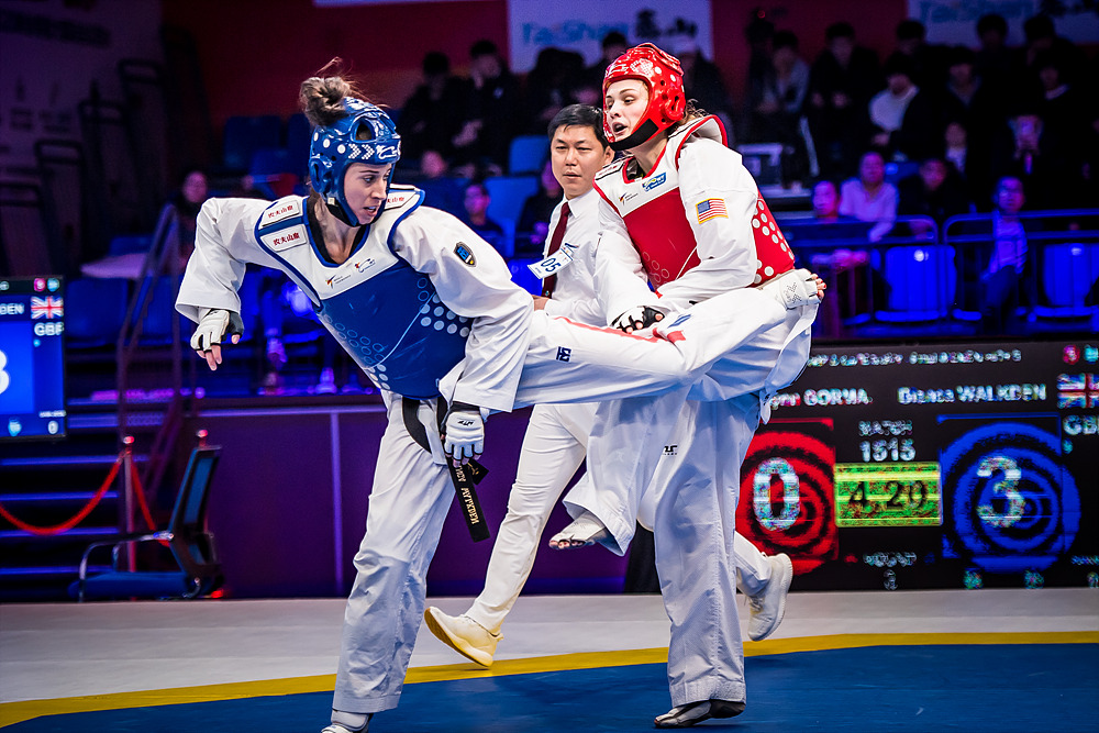 Team GB's Bianca 'Queen Bee' Walkden (left) unleashes a spinning back kick on her way to winning the gold medal and $70,000 in prizemoney at the World Taekwondo Grand Slam in Wuxi, China. Photo: World Taekwondo