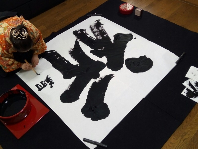 Shoko Kanazawa adds the finishing touches to her calligraphy for 2019, 'Prayer.' Photo: Jason Morgan/Asia Times
